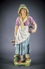 FRENCH MAJOLICA FIGURE OF A MILK MAID