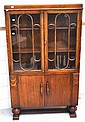 A 1930's oak glazed display cabinet with cupboard