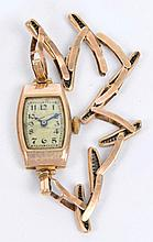 A vintage ladies 9ct gold cased manual wind