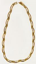 A 9ct gold necklace comprising pierced slightly