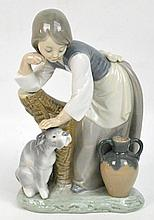 A Lladro figure of a girl stroking a dog leaning