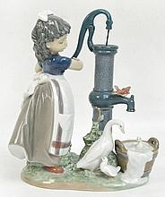 A Lladro figure group depicting a girl at a well.