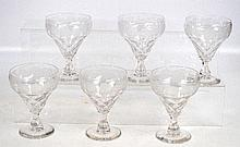 A set of six glass sundae glasses with etched