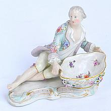 A late 19th century Meissen figure salt, the
