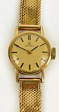 A vintage 9ct gold cased Omega ladies manual wind