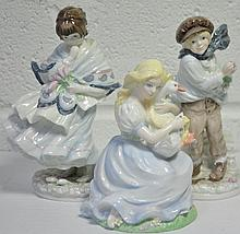 Three Coalport figures.