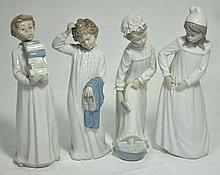 Four Nao figures depicting children in night