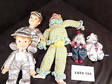 Three clown dolls and two Baby Genius dolls