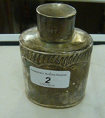 A late Victorian silver tea caddy of shouldered,