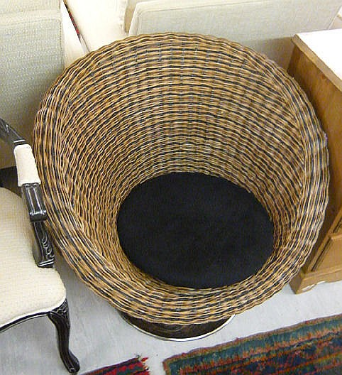 A modern Italian woven cane tub chair, raised on a