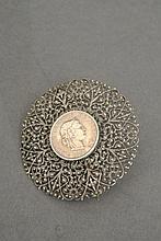 A very fine silver filigree brooch