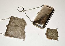Three silver evening purses, to include: a George