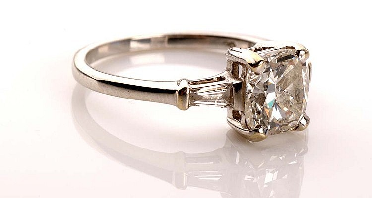 A single stone diamond ring, the cushion cut