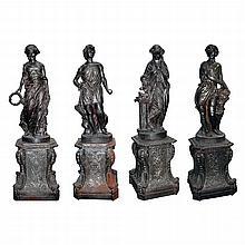 Set of Four Cast Iron Garden Figures -