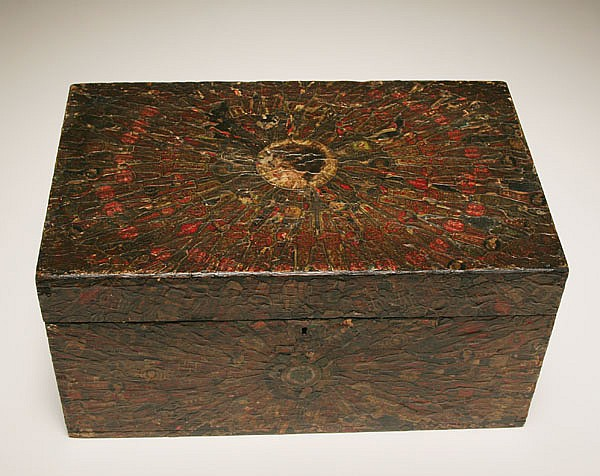Folk art chest decorated with cigar band and label collage;
