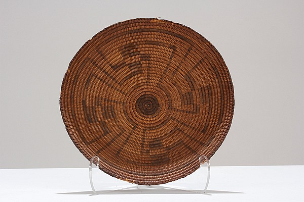 Pima Native American coil basket with geometric whirling log pattern.