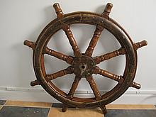 Antique metal and wood wheel helm