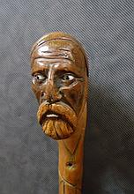 ANTIQUE WOODEN CANE WITH CARVED SAILOR HEAD