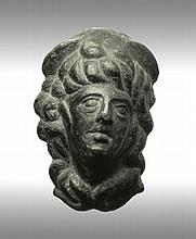 Bust of young god. Roman, circa 1st-2nd century AD.