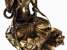 Brass Bronze Figure of a Guanyin on a Lion Dog, China, 20th C