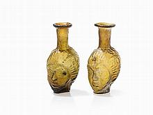 Two Glass Bottles with Janus Heads, Roman, 3rd/2nd C. BC