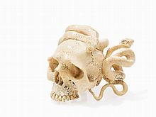 Skull with Snakes Carved of Fossil Bones