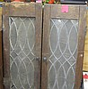 Group of four antique leaded glass hinged cupboard doors
