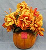 Pumpkin shaped vase with autumn flower arrangement