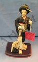 Vintage geisha Girl doll on base