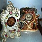 Two ceramic decorative clocks, one German with