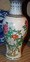 Chinese porcelain vase with floral decoration on a