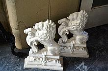 Pair of vintage cast iron door stops, each in the