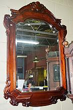 Ornate carved mahogany framed wall mirror,