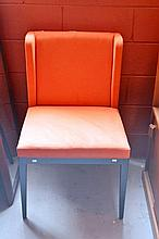 Modern designer reception chair with orange