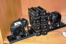 Pair of carved ebony elephant form bookends with