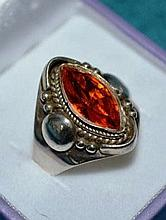 Ornate silver ring with amber coloured central