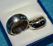 2 silver rings, possibly gents/weddings bands