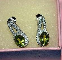 Pair of silver earrings with peridot setting