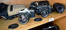 2 Pentax SLR cameras, a P30 and a ME Super, each
