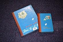2 blue stamp albums - 1 medium size, 1 small size