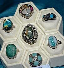 7 various silver rings set with various stoness