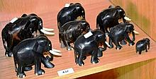 Collection of 8 carved ebony elephants with ivory