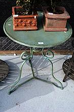 Single French bistro style outdoor metal table,