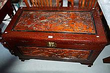 A well carved Oriental camphorwood chest, brass