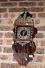 Dutch wall clock, stool style, with twin brass