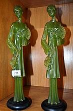 Pair of cast green resin figures of Asian maidens