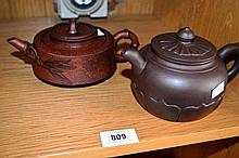2 Chinese terracotta teapots with engraved detail,