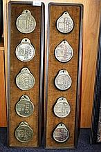 2 wooden plaques each holding 5 cast bronze Korean