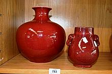 2 oriental red glazed vases, 1 with twin elephant
