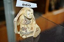 Japanese carved bone netsuke with figure of a man